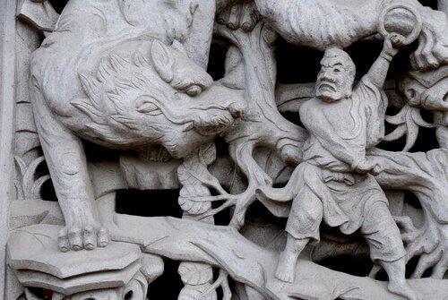 Tigre e uomo in un bassorilievo cinese